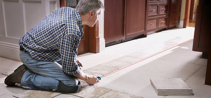 man measuring the floor