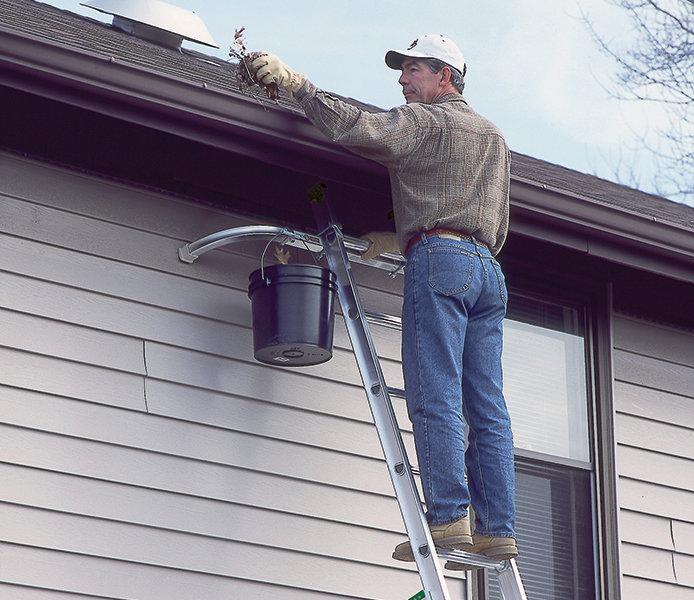 Cleaning gutters by hand